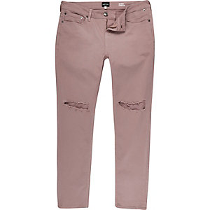 Pink ripped Sid skinny jeans