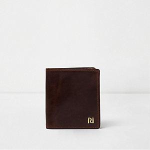 Donkerbruine uitklapbare leren portemonnee
