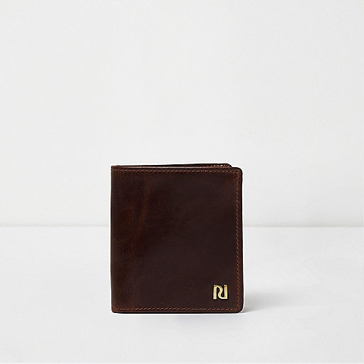 Dark brown leather fold out wallet