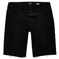Black frayed skinny denim shorts