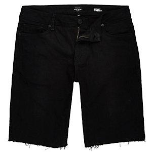 Black frayed skinny denim shorts