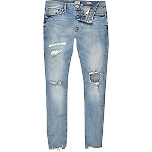 Light blue wash ripped Sid skinny jeans