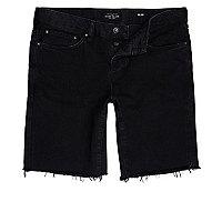 Short en jean slim noir à bords effilochés