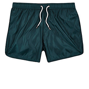 Turquoise runner swim trunks