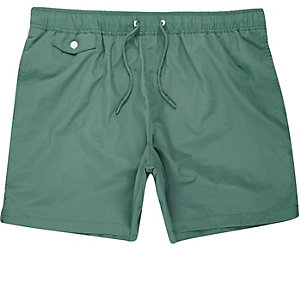 Green pocket swim trunks