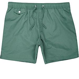 Green pocket swim trunks
