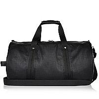 Black perforated holdall bag