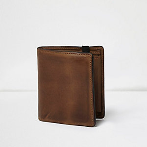 Tan leather foldout wallet