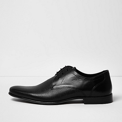 Black embossed leather formal shoes