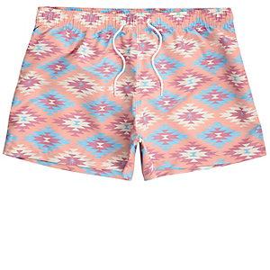 Pink aztec print slim fit swim shorts
