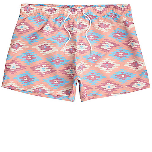 Pink aztec print slim fit swim trunks