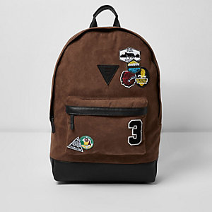 Light brown faux suede badge backpack