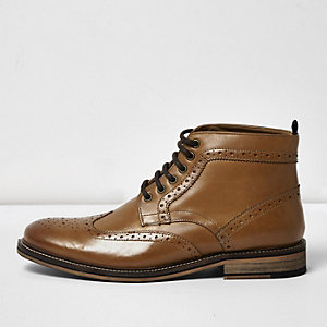 Brown leather brogue boots