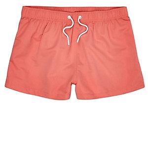 Coral slim fit swim trunks
