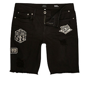 Black frayed badge skinny denim shorts