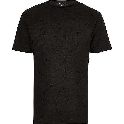 Schwarzes T-Shirt mit Rundhalsausschnitt im Used Look
