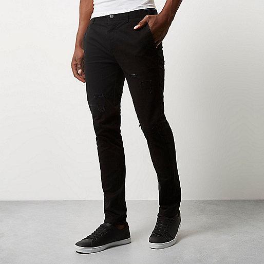 Black ripped skinny chino pants