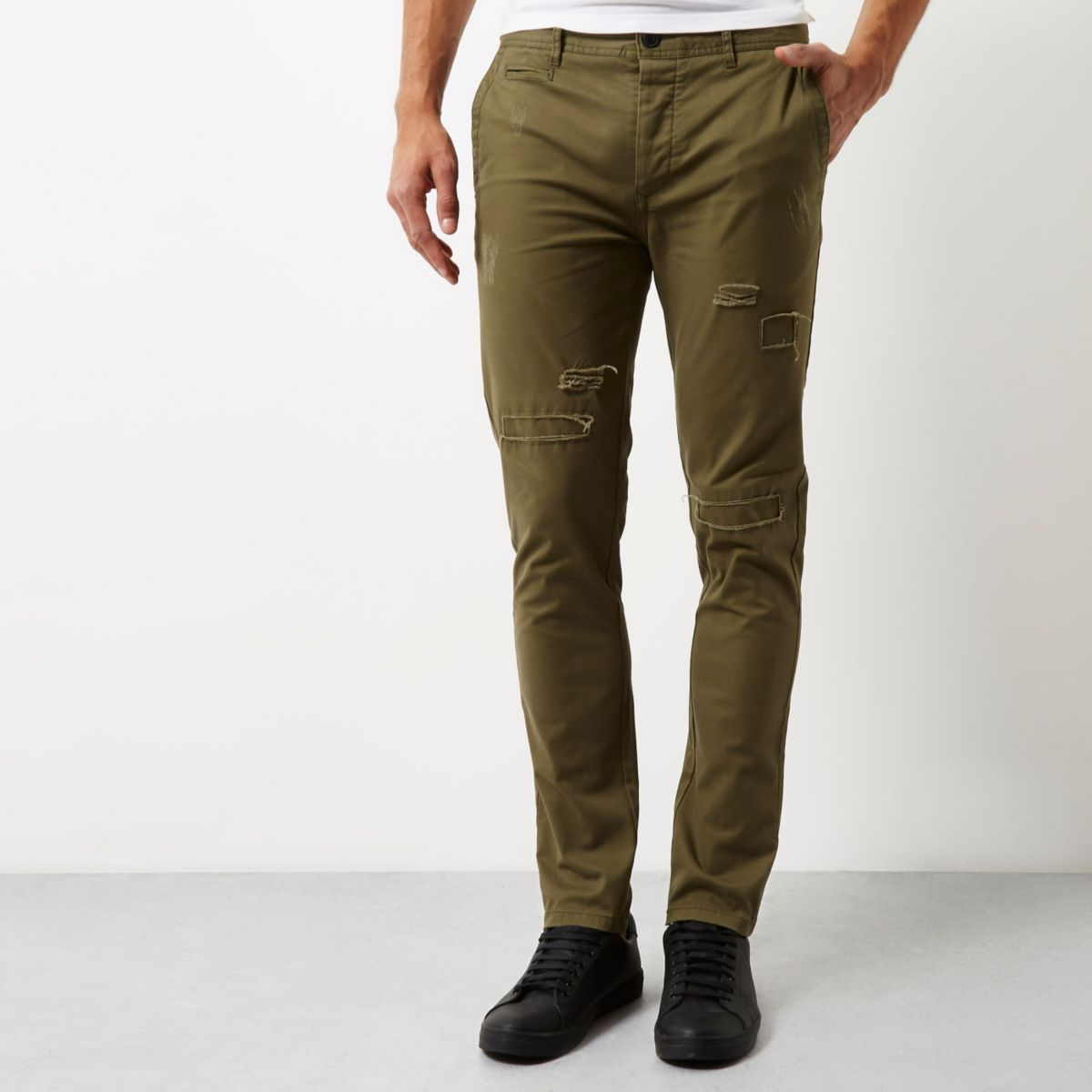 Green ripped skinny chino pants
