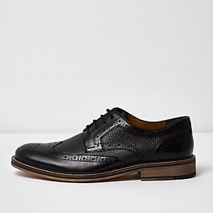 Black textured leather brogues