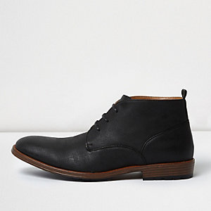 Black perforated chukka boots