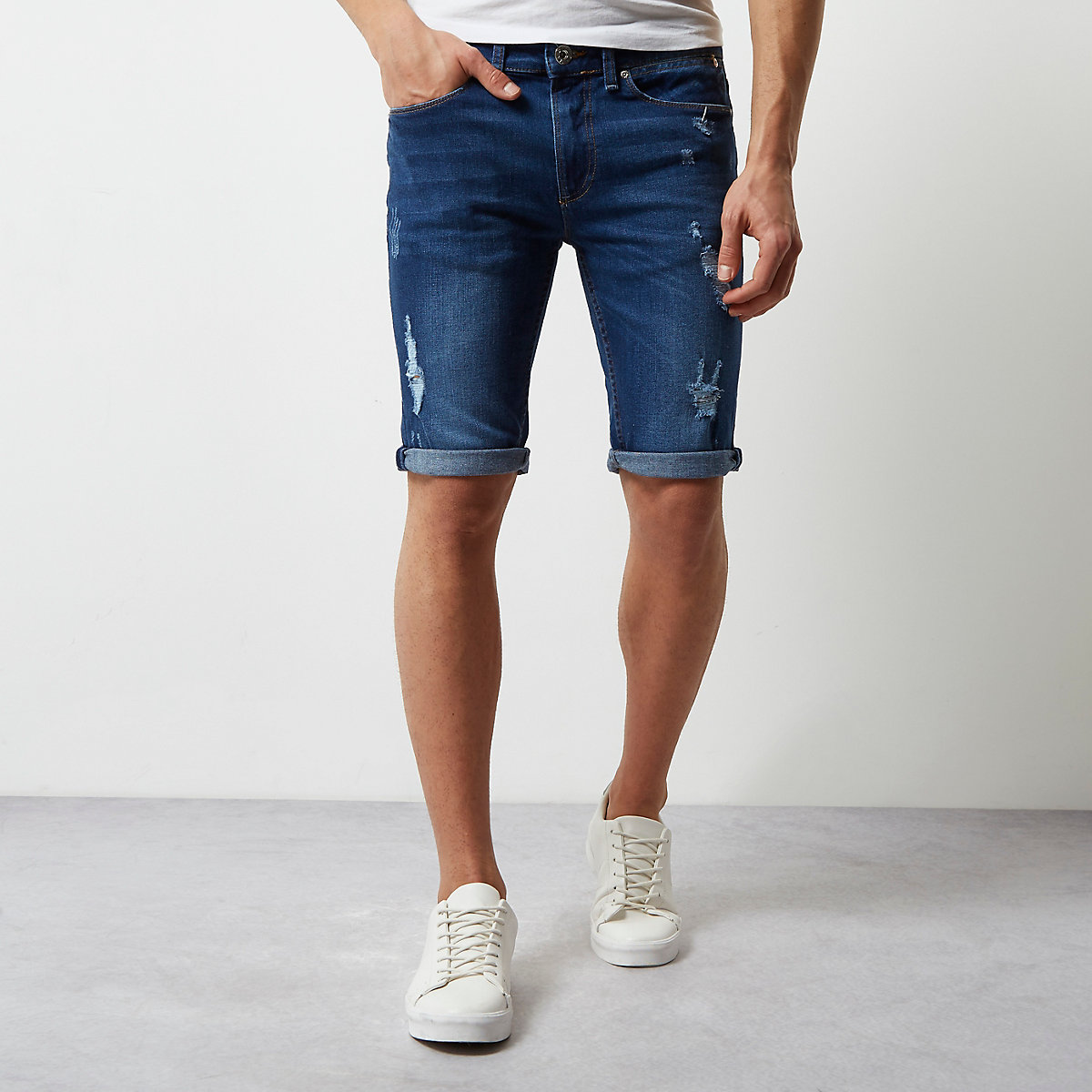 Mid blue wash skinny ripped denim shorts