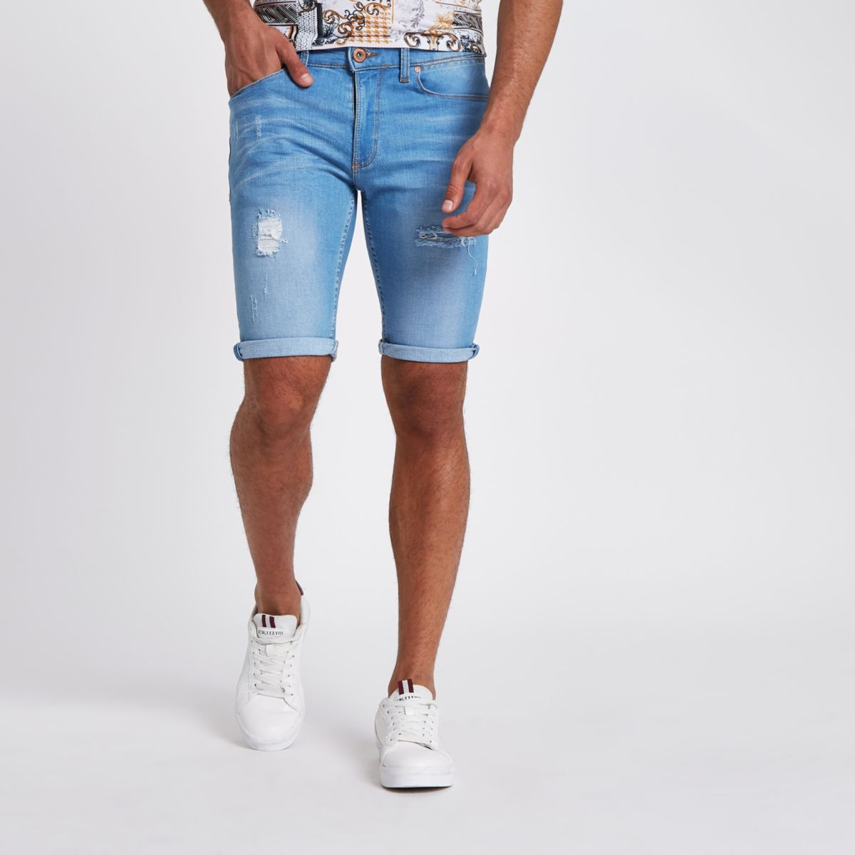 Light blue wash skinny ripped denim shorts