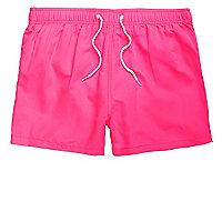 Pink neon swim trunks