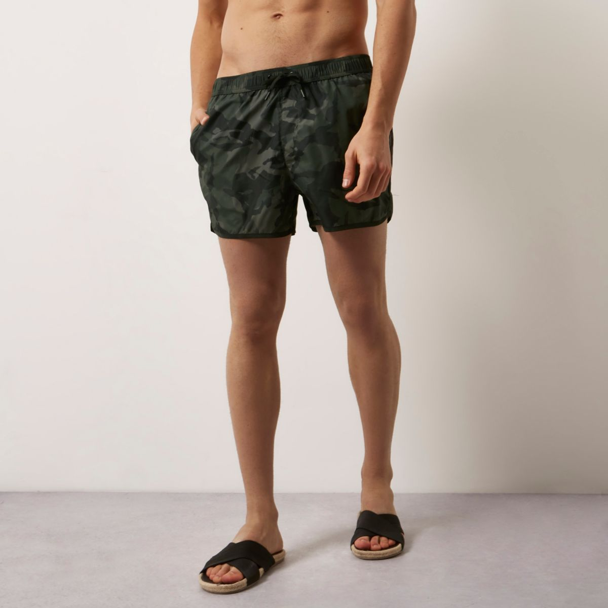 Dark green camo print short swim trunks