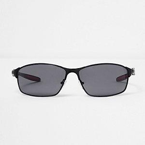 Zwarte rondlopende zonnebril met rubberlaag