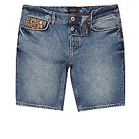 Blue leopard patch skinny fit shorts