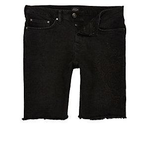 Short en jean stretch noir style western à bord brut