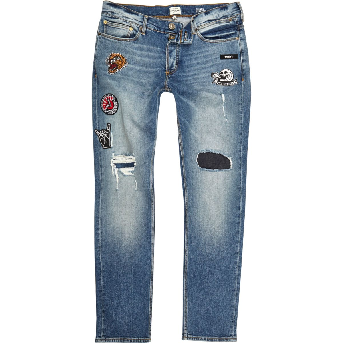 Blue wash ripped badge Sid skinny jeans