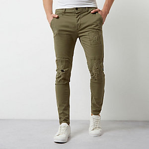 Khaki green distressed skinny pants