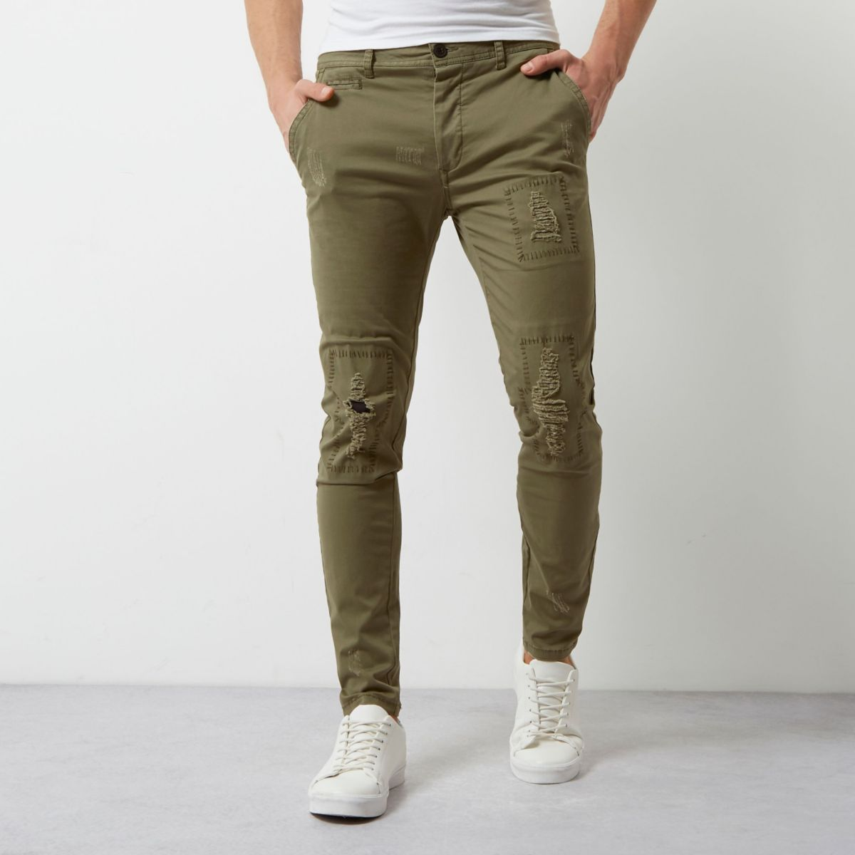 Khaki green distressed skinny trousers