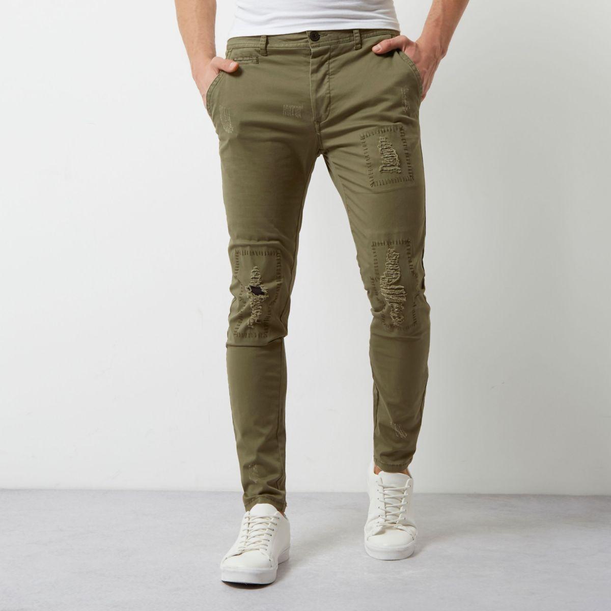 Khaki green distressed skinny pants