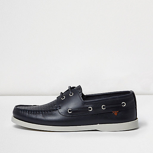 Navy blue leather woven boat shoes