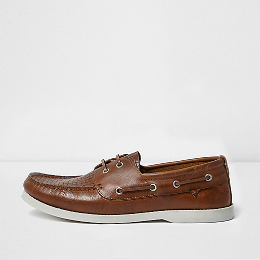 Tan woven boat shoes