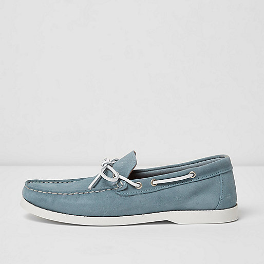 Light blue suede boat shoes