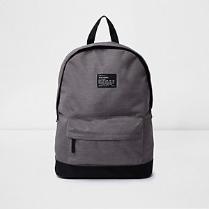 Grey zip pocket backpack