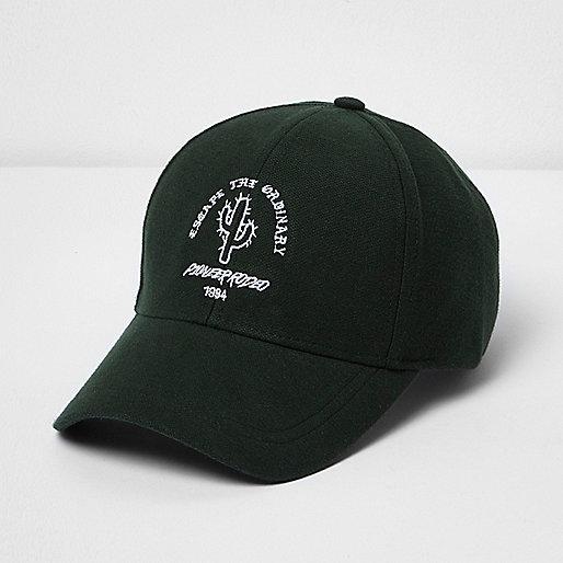Dark green 'escape the ordinary' cap