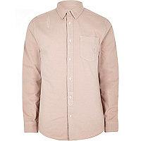 Pink distressed denim shirt