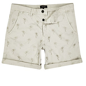 Beige palm tree print rolled up shorts