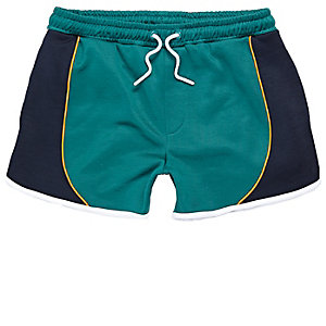 Green sporty runner shorts