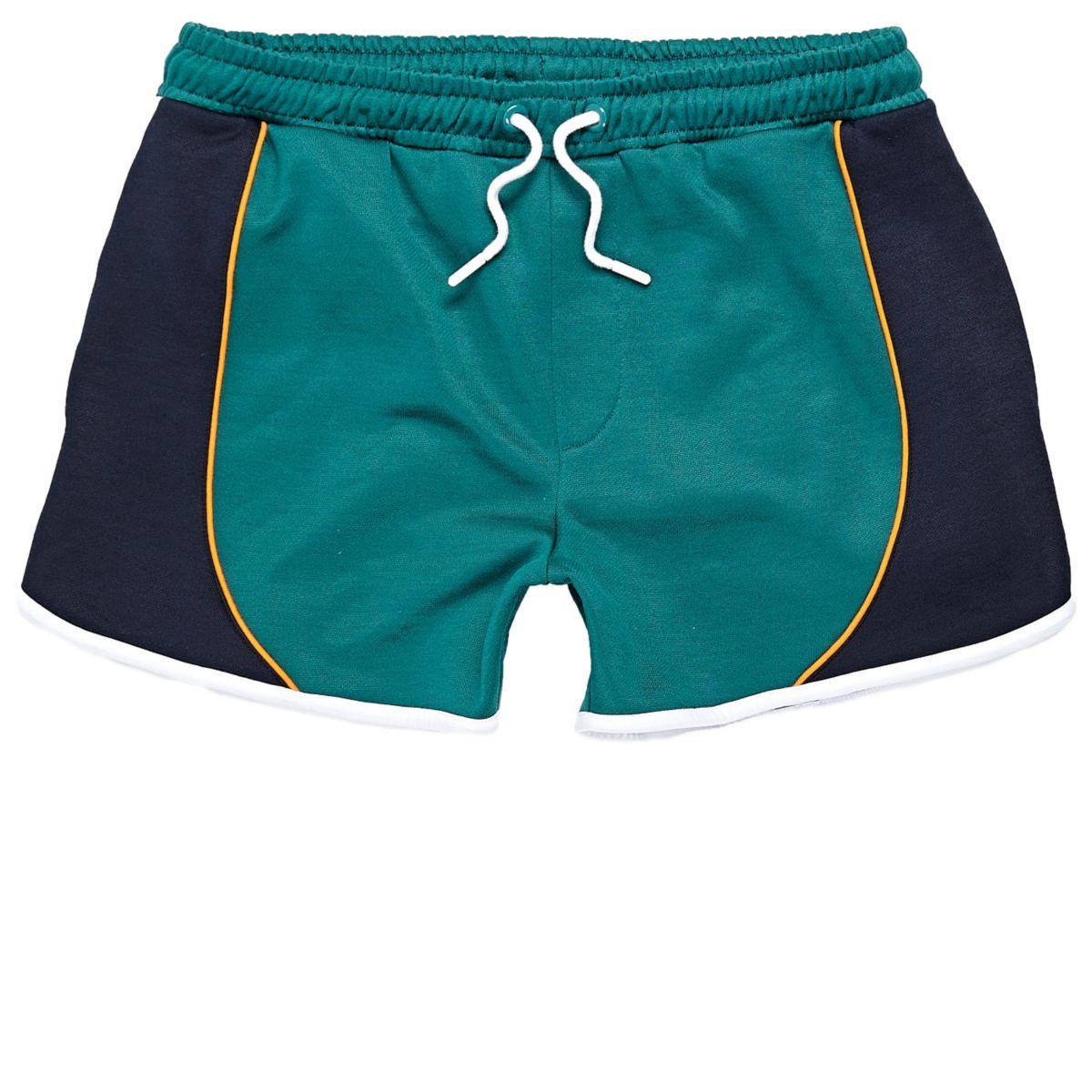 Green sporty runner shorts