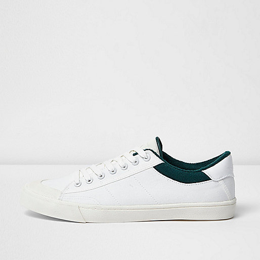 White canvas plimsolls