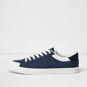 Navy blue canvas plimsolls