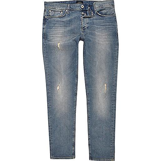 Mid blue wash distressed skinny Sid jeans