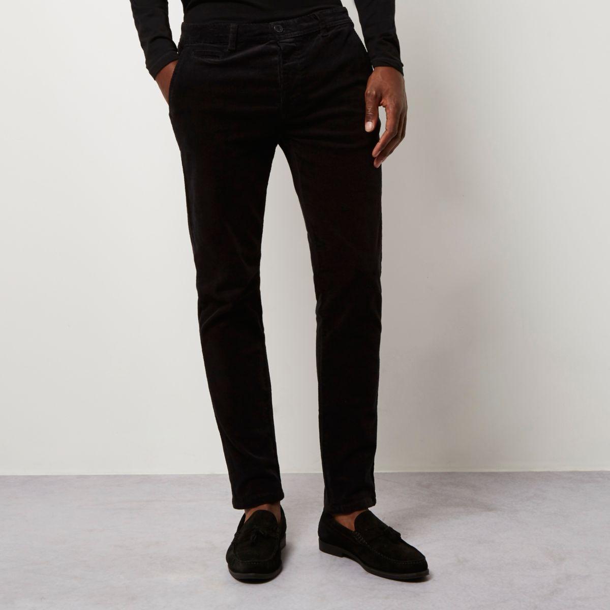 Pantalon chino skinny noir en velours côtelé