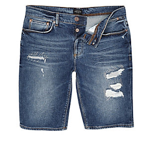 Dark blue wash distressed denim shorts