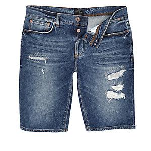 Short en jean bleu foncé délavé usé